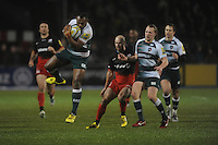 Vereniki Goneva of Leicester Tigers secures the high ball as team mate Sam Harrison and Charlie Hodgson of Saracens look on during the Premiership Rugby match between Saracens and Leicester Tigers - 02/01/2016 - Allianz Park, London<br /> Mandatory Credit: Rob Munro/Stewart Communications