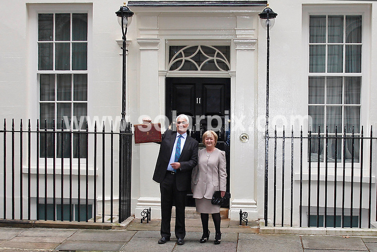 **ALL ROUND PICTURES FROM SOLARPIX.COM**.**WORLDWIDE SYNDICATION RIGHTS**.Chancellor of the Exchequer Alistair Darling and his wife Magie Darling poses with a briefcase containing the Budget Report outside Downing Street in London on Wednesday 24 March 2010. The Labour government will deliver a critical pre-election budget to help fix the dire public finances but some experts fear political posturing with an election around the corner..This pic:   Alistair Darling and his wife Magie Darling.JOB REF:   10970    LDN     DATE:  24.03.10.**MUST CREDIT SOLARPIX.COM OR DOUBLE FEE WILL BE CHARGED**.**MUST NOTIFY SOLARPIX OF ONLINE USAGE**.**CALL US ON: +34 952 811 768 or LOW RATE FROM UK 0844 617 7637**