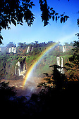 Iguassu Falls, Brazil; view of the waterfalls with a rainbow over them. Parana State.