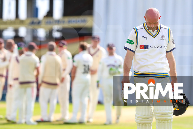 Adam Lyth of Yorkshire leaves the field of play after he is caught off the bowling of Josh Davey of Somerset during the 2nd day Specsavers County Championship match between Yorkshire and Somerset at Headingley Cricket Ground, St Michaels Lane, England on 30 August 2018. Photo by Thomas Gadd.