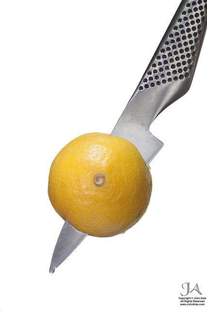 Global Paring Knife with lemon with High Key Lighting
