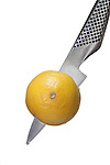 Global Paring Knife with lemon with High Key Lighting