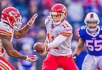 9 November 2014: Kansas City Chiefs quarterback Alex Smith makes a fourth quarter hand-off against the Buffalo Bills at Ralph Wilson Stadium in Orchard Park, NY. The Chiefs rallied with two fourth quarter touchdowns to defeat the Bills 17-13. Mandatory Credit: Ed Wolfstein Photo *** RAW (NEF) Image File Available ***