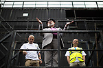© Joel Goodman - 07973 332324 . 26/06/2017 . Manchester , UK . Revd David Gray speaks ahead of the walk . Fire-fighters wearing symbolic Manchester bee t-shirts walk from Manchester Central Fire Station to St Ann's Square in Manchester City Centre for a short ceremony and release of 22 doves , in commemoration of the 22 people killed in a murderous terrorist attack , carried out by Salman Abedi , following an Arina Grande concert at the Manchester Arena , on 22nd May 2017 . Local fire crews have expressed frustration after they were held back from attending to support other emergency services for nearly two hours after the bombing , on the night of the attack . Photo credit : Joel Goodman