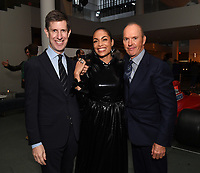 """NEW YORK CITY - OCTOBER 4: Craig Erwich, President, Hulu & ABC Entertainment , Rosario Dawson, and Michael Keaton attend the red carpet premiere of Hulu's """"DOPESICK"""" at the Museum of Modern Art on October 4, 2021 in New York City. . (Photo by Frank Micelotta/Hulu/PictureGroup)"""