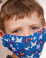 Little Boy with fun medical mask with american colors