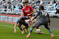 SAINT PAUL, MN - MAY 15: Ethan Finlay #13 of Minnesota United FC and Ryan Hollingshead #12 of FC Dallas battle for the ball during a game between FC Dallas and Minnesota United FC at Allianz Field on May 15, 2021 in Saint Paul, Minnesota.