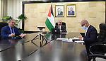 Palestinian Prime Minister Mohammed Ishtayeh meets with President of the European Bank for Reconstruction and Development, Odile Reno Basso, via video conference, in the West Bank city of Ramallah, on April 15, 2021. Photo by Prime Minister Office