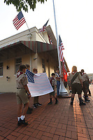 Boy Scouts from Troop 36 in Bentonville Caden Dancer (from left), Benji Wessels (cq), Tristan Browning and Jack Hudson present Saturday Sept. 11 2021 the 9-11 Flag of  Honor during the 9-11 remembrance ceremony on the Bentonville square. Go to nwaonline.com/210912Daily to see more photos.<br />(NWA Democrat-Gazette/Flipi Putthoff)