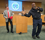 Houston ISD Superintendent Dr. Terry Grier, left, dances along as Curtis Harris, right, performs a bit from his bus safety song during a central office staff meeting, November 19, 2013.