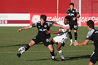 RICHMOND, VA - SEPTEMBER 30: Deri Corfe #88 of New York Red Bulls II tries to keep Pecka #7 of North Carolina FC away from the ball during a game between North Carolina FC and New York Red Bulls II at City Stadium on September 30, 2020 in Richmond, Virginia.