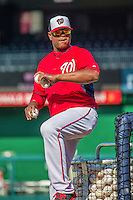 20 May 2014: Washington Nationals Bullpen Catcher Nilson Robledo throws batting practice prior to a game against the Cincinnati Reds at Nationals Park in Washington, DC. The Nationals defeated the Reds 9-4 to take the second game of their 3-game series. Mandatory Credit: Ed Wolfstein Photo *** RAW (NEF) Image File Available ***