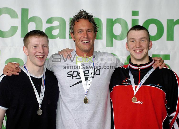 Pix: Chris Whiteoak/SWpix.com. Swimming, British Swimming World Championships 2005, Manchester. 17/03/2005...COPYRIGHT PICTURE>>SIMON WILKINSON>>01943 608782>>..Winners of the mens 50m Butterfly, Gold Mark Foster, Silver Owen Morgan, Bronze David Leith