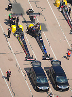 Apr. 28, 2012; Baytown, TX, USA: Aerial view of NHRA top fuel dragster driver Doug Kalitta (left) and teammate David Grubnic during qualifying for the Spring Nationals at Royal Purple Raceway. Mandatory Credit: Mark J. Rebilas-
