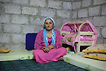 DOMIZ, IRAQ: Berivan sits in her shelter in the Domiz refugee camp....Over 7,000 Syrian Kurds have fled the violence in Syria and are living in the Domiz refugee camp in the semi-autonomous region of Iraqi Kurdistan...Photo by Ali Arkady/Metrography