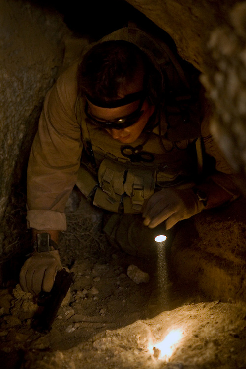 26 August 2007, Cpl. Robert D. Smith, from Regimental Combat Team 2, climbs out of an underground cave after searching it for people living inside. No one was found, however there was evidence of people once being there. Marines with RCT-2 are performing an aero-scout mission in the northern part of Al Anbar to search for vehicles driving through open desert, possible insurgent camps, and any insurgent activity. RCT-2 is deployed with Multi National Forces-West in support of Operation Iraqi Freedom in the Al Anbar province of Iraq to develop Iraqi Security Forces, facilitate the development of official rule of law through democratic reforms, and continue the development of a market based economy centered on Iraqi reconstruction. (Official USMC photograph by Cpl. Shane S. Keller)