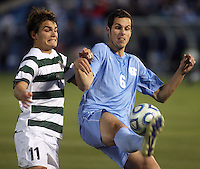 Charlotte's Guiseppe Gentile (11) and North Caolina's Matt Hedges (6) battle for the ball during the NCAA 2011 Men's College Cup in Hoover, AL on Sunday, December 11, 2011.