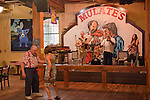Diners take a moment to dance to Jonno Frishberg's band at Mulate's, a family-style restaurant specializing in Cajun food and music in New Orleans, Louisiana.