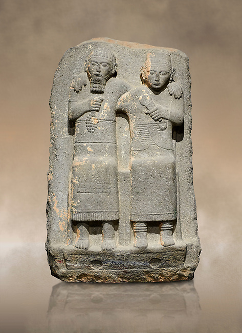 Hittite monumental relief sculpture of of two seated figure, not a typical Hittite style with a lot of other influences. Late Hittite Period - 900-700 BC. Adana Archaeology Museum, Turkey.