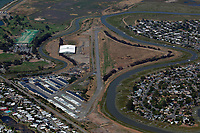 aerial photograph of the San Rafael Airport, also known as Smith Ranch (CA35), San Rafael, Marin County, California. Galinas Creek (left of the runway) and the South Fork of Galinas Creek join just beyond the airport.  The airport recreational facility is housed in the large structure between the runway and Galinas Creek.