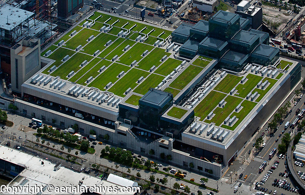 aerial photograph of the green roof on the Jacob K. Javits Convetion Center, Manhattan, New York City; the green roof covers 297,000 square feet making it the second largest green roof on a free standing building in the United States.  The green roof has won many design awards, The roof retains about three quarters of the rainwater that falls on it, hosts 26 species of birds, species of bats and numerous honey bee hives. This aerial photograph also shows the over 100 energy efficient HVAC units installed on the roof.