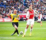 Nederland, Amsterdam, 19 april 2015<br /> Eredivisie<br /> Seizoen 2014-2015<br /> Ajax-NAC Breda (0-0)<br /> Henrico Drost (l.) van NAC Breda en Viktor Fischer van Ajax strijden om de bal