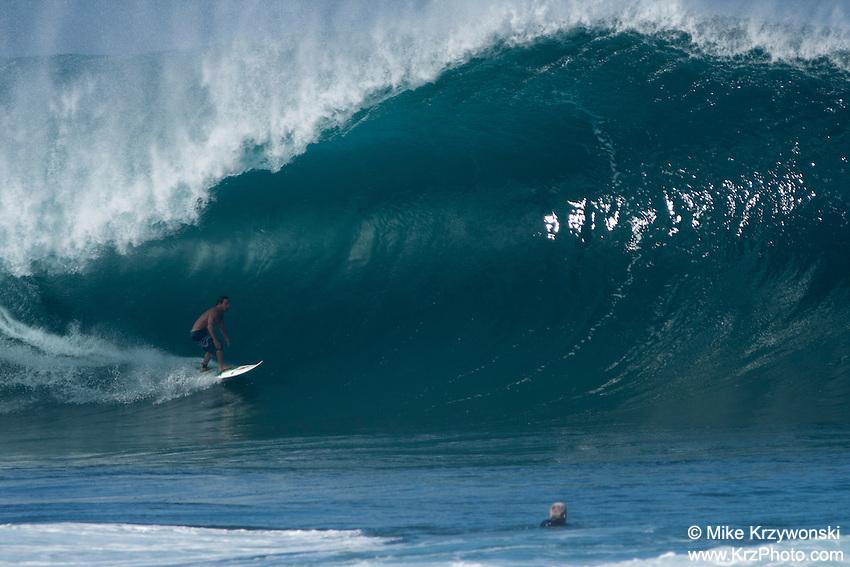 Pro Surfer Kalani Chapman getting barreled on a big wave at Pipeline, North Shore, Oahu