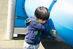 Education Preschool 3-4 year olds discouraged boy leaning against playground equipment