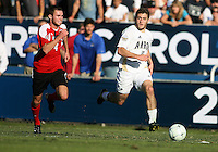 Chris Korb #16 of the University of Akron runs away from Ryan Smith #4 of the University of Louisville during the 2010 College Cup final at Harder Stadium, on December 12 2010, in Santa Barbara, California.Akron champions, 1-0.