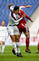 Martina Franko of Canada and Shannon Boxx of the USA. The U.S. defeated Canada, 4-0, during the Four Nations Tournament in Guangzhou, China on January 16, 2008.