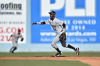 Charleston RiverDogs shortstop Jorge Mateo (2) fields and throws to first during a game against the Asheville Tourists on June 13, 2015 in Asheville, North Carolina. The Tourists defeated the RiverDogs 10-6. (Tony Farlow/Four Seam Images)