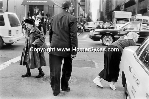 New York  Lunch time rush hour Manhattan. Disabled woman using a walking frame dragging her leg  2001 USA