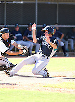 Marcus Littlewood (Seattle Mariners - 2010 Instructional League) is safe at home as White Sox catcher Rafael Vera was unable to hold onto the throw to home..Photo by:  Bill Mitchell/Four Seam Images..
