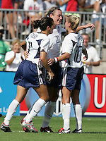 Julie Foudy, left, Abby Wambach, middle, Aly Wagner, right, USA vs China, 2004.