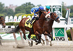 June 9, 2012. #4 Love to Run, Junior Alvarado up, passes Tiz Yankee (inside), Corey Nakatani up, to win race 2 on Belmont Stakes Day, a one-mile contest for maidens three years old and upward at Belmont Park in Elmont, New York. ©Joan Fairman Kanes/Eclipsesportswire