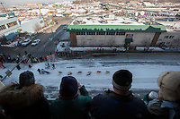 Spectators watch from atop a parking garage as dog teams leave the starting line at the ceremonial start of the 2014 Iditarod Dogsled Race in downtown Anchorage, Alaska. Sixty-nine mushers paraded their teams through Anchorage today and will depart from the official start in Willow tomorrow to begin the 975-mile race to Nome.