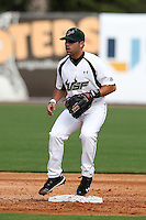 """University of South Florida Peter Brotons #13 during a game vs. the Miami Hurricanes in the """"Florida Four"""" at George M. Steinbrenner Field in Tampa, Florida;  March 1, 2011.  USF defeated Miami 4-2.  Photo By Mike Janes/Four Seam Images"""