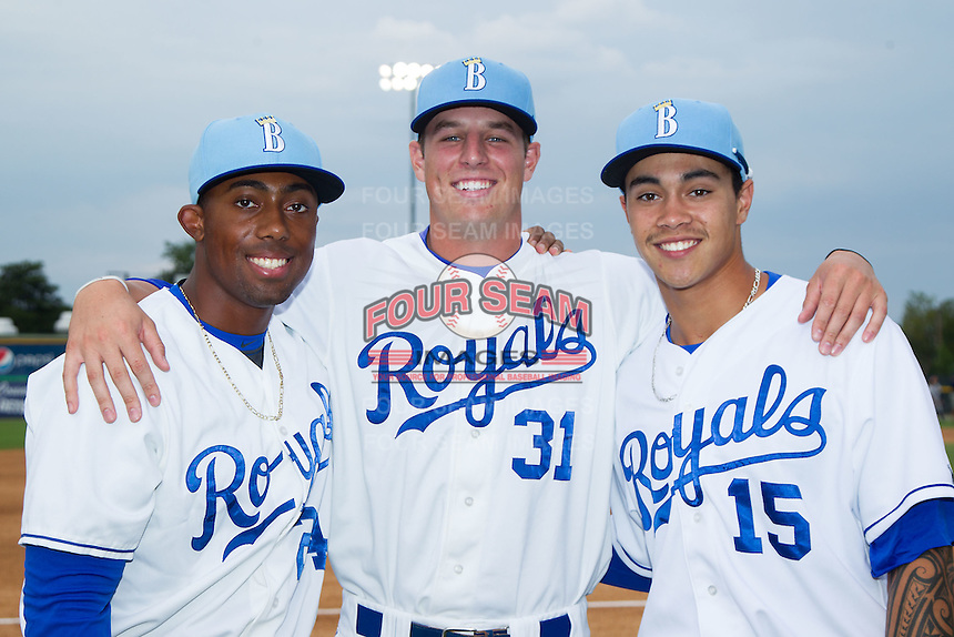 (L-R) Alex Newman (24), Riley King (31) and Amalani Fukofuka (15) pose for a photo prior to the game against the Princeton Rays at Burlington Athletic Park on July 9, 2014 in Burlington, North Carolina.  The Rays defeated the Royals 3-0.  (Brian Westerholt/Four Seam Images)
