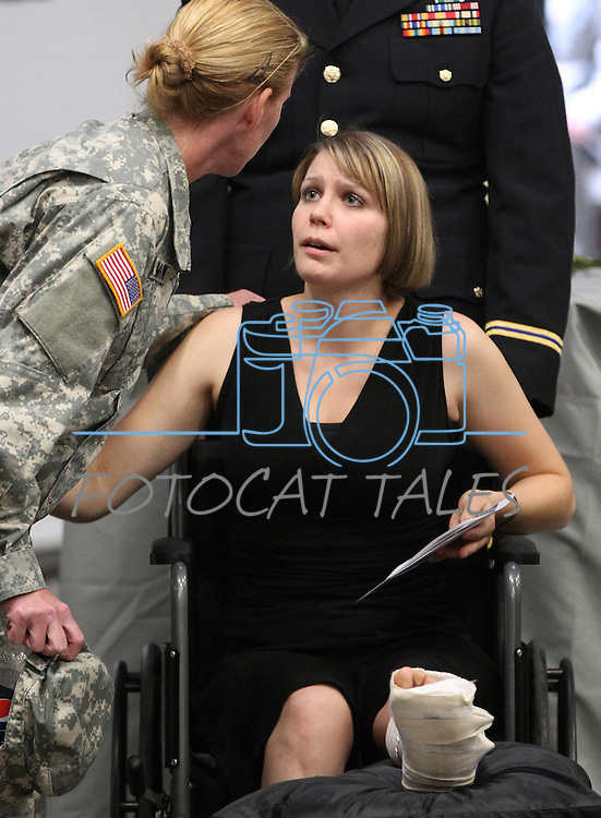 Sgt. 1st Class Cait Kelley talks with a suporter following a memorial in Carson City, Nev., on Sunday, Sept. 11, 2011., honoring the three Nevada National Guard members killed earlier this week by a gunman in an IHOP restaurant. Kelley was one of seven people also injured in the attack. (AP Photo/Cathleen Allison)