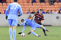 Houston, TX - Friday December 9, 2016: Adam Mosharrafa (16) of the Stanford Cardinal knocks over Zach Wright (10) of the North Carolina Tar Heels while going for the ball at the NCAA Men's Soccer Semifinals at BBVA Compass Stadium in Houston Texas.