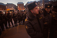 Police stand in a line around protestors during an illegal protest against Putin in Lubyanka Square in Moscow, Russia.