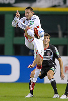 New England Revolution forward Clint Dempsey (2) leaps in the air to keep control of the ball in front of defender Brandon Prideaux (4). The New England Revolution defeated DC United 2-1, Saturday, October 7, 2006, at RFK Stadium.