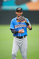 Akron RubberDucks Angel Miguel (7) during warmups before the first game of a doubleheader against the Bowie Baysox on June 5, 2016 at Prince George's Stadium in Bowie, Maryland.  Bowie defeated Akron 6-0.  (Mike Janes/Four Seam Images)