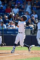 New York Yankees pinch hitter Oswaldo Cabrera (97) follows through on a swing during a Grapefruit League Spring Training game against the Toronto Blue Jays on February 25, 2019 at George M. Steinbrenner Field in Tampa, Florida.  Yankees defeated the Blue Jays 3-0.  (Mike Janes/Four Seam Images)