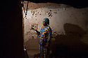 Morocco - Ouarzazate - Kabira Oufakkir, 37, stands in front of her room carrying a bird's cage in her hand. A destitute mother of two, Kabira Oufakkir has been living in the Kasbah Taourirt of Ouarzazate for the past 16 years, renting a modest room she shares with her two sons. A maid and cleaning lady, thanks to her dark skin Oufakkir has participated in several historical and biblical movies, such as Abraham, Moses and Isaiah, generally acting as a slave. She recently featured in a Moroccan movie, acting as an African migrant crossing the Sahara in order to reach Europe.