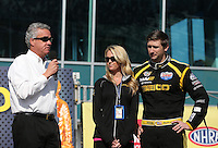 Mar. 17, 2013; Gainesville, FL, USA; NHRA Graham Light (left) with top fuel dragster driver Morgan Lucas (right) and wife Katie Lucas during the Gatornationals at Auto-Plus Raceway at Gainesville. Mandatory Credit: Mark J. Rebilas-