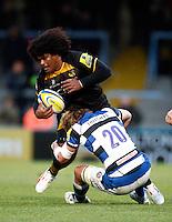 Photo: Richard Lane/Richard Lane Photography. London Wasps v Bath Rugby. Aviva Premiership. 24/11/2013. Wasps' Ashley Johnson is tackled by Bath's Will Skuse.