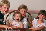 portrait of siblings boys ages 8 and 5 and girls ages 2   and 13 months horizontal
