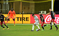 WASHINGTON, DC - SEPTEMBER 27: Gustavo Bou #7 of New England Revolution battles for the ball with Junior Moreno #5 and Frederic Brilliant #13 of D.C. United during a game between New England Revolution and D.C. United at Audi Field on September 27, 2020 in Washington, DC.