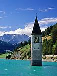 Italy, South-Tyrol, Alto Adige, Val Venosta, Old-Graun at Reschen passroad, submerged at Reschen Lake, dammed 1949/1950 | Italien, Suedtirol, Vinschgau, Alt-Graun am Reschenpass, durch Stauung des Reschensees 1949/50 versank das Dorf in den Fluten, nur der Kirchturm schaut heute noch heraus
